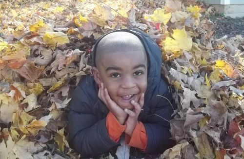 Jordan Playing in the Leaves, photo by Dad