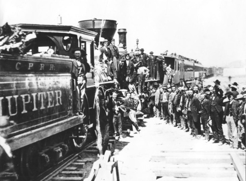 Celebration of completion of the First Transcontinental Railroad at what is now Golden Spike National Historic Site, Promontory Summit, Utah. Photo by A. J. Russell, 1869