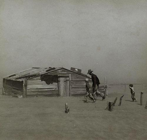 Farmer and sons walking in the face of a dust storm. Cimarron County, Oklahoma, photo by Arthur Rothstein, 1936.