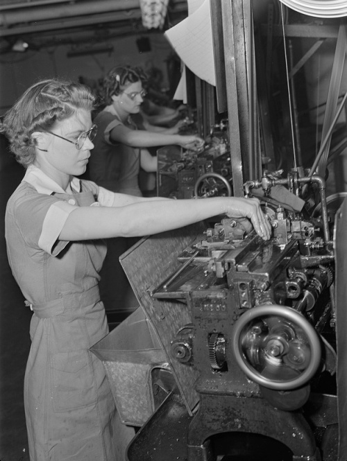 Women in industry. Tool production. Arms for the love of America! The capable young woman whose strong hands guide this cutoff machine is one of a Midwest drill and tool factory's many women employees. Almost 1,000 women have recently been employed in this comparatively new plant; sole men workers, other than foreman, are those in the heat treating department. Republic Drill and Tool Company, Chicago, Illinois, photo by Ann Rosener, 1942.