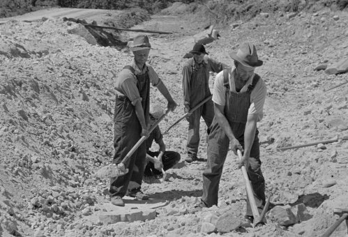 Scottsboro (vicinity), Alabama. Farmers who have been resettled at work in a sand pit at Cumberland Mountain Farms, a U.S. Resettlement Administration project, photo by Arthur Rothstein, 1935.
