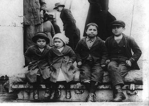 Four children seated on a ship, following battle for Thessaloniki between Bulgaria and Greece, 1912.