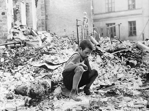 Polish kid in the ruins of Warsaw, September 1939, by Julien Bryan