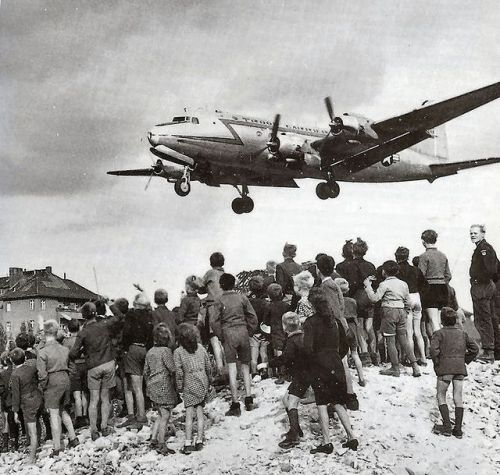 Berliners watch a C-54 Skymaster land at Tempelhof Airport, 1948