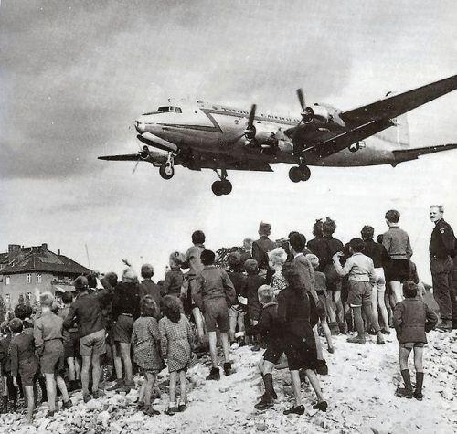 Berliners watch a C-54 Skymaster land at Tempelhof Airport, 1948
