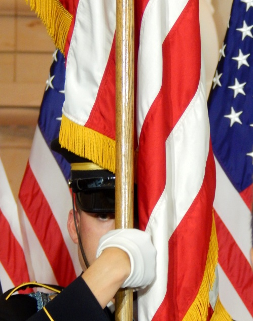 Member of U.S. Army Color Guard retiring the colors.